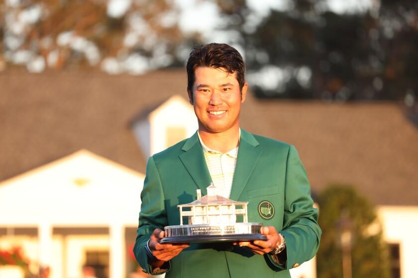 Hideki Matsuyama holds trophy as 2021 Masters champion