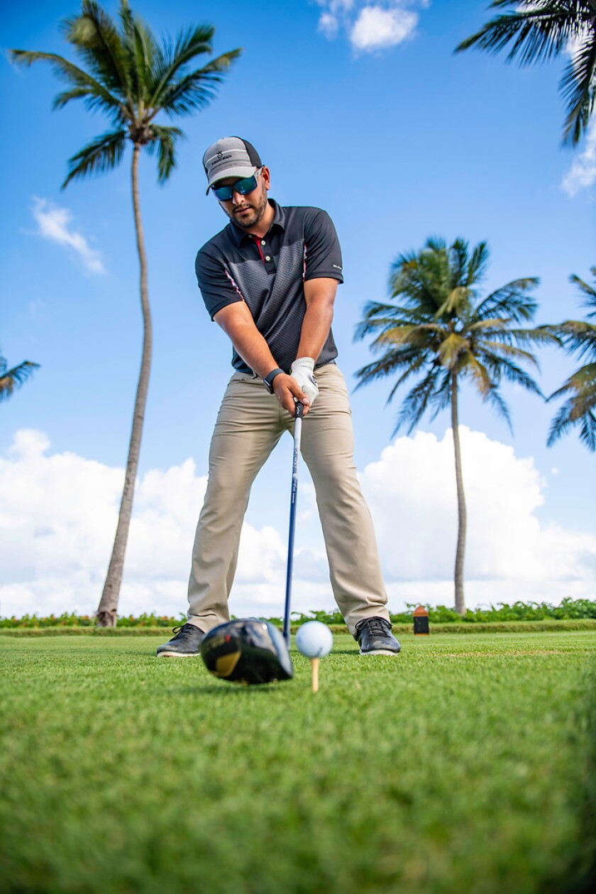 Golfer in Puerto Rico with tropical setting in background