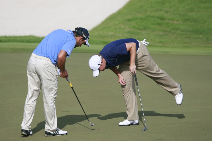 Golfers checking for spike marks