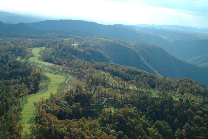Aerial image of The Highland Course and surrounding mountain peaks.jpg
