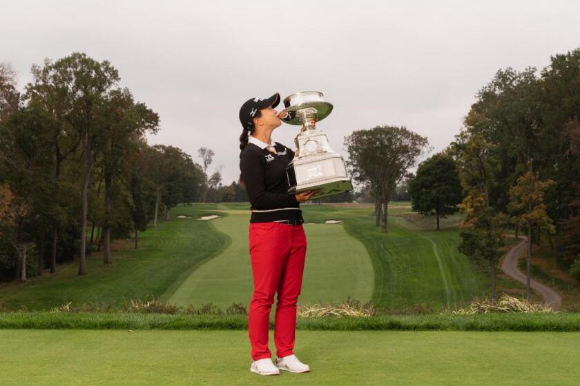 Sei Young Kim celebrates victory at the 2020 KPMG Women's PGA Championship at Aronimink Golf Club in Newtown Square, Pa.