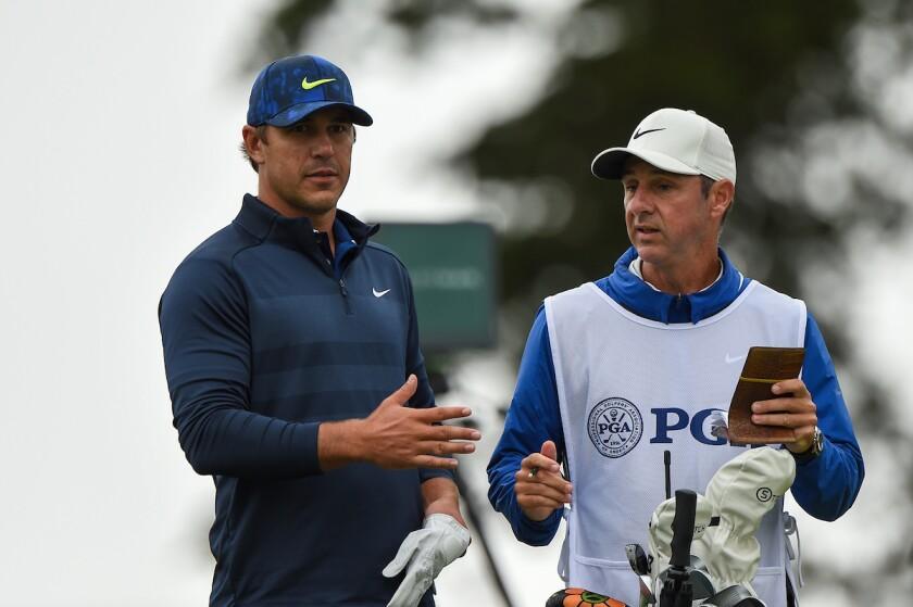 Brooks Koepka and caddie Ricky Elliott at 2020 PGA Championship