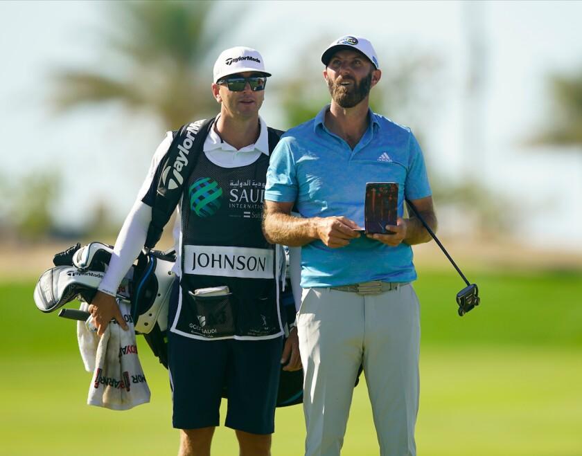Dustin Johnson and caddie Austin Johnson at 2021 Saudi International