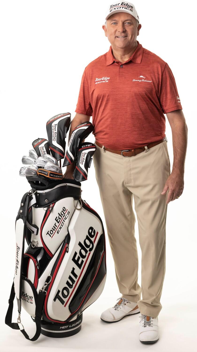 Ken Duke with Staff bag.jpg
