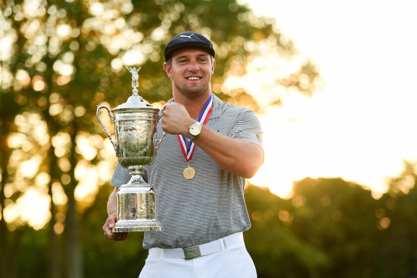 Bryson DeChambeau holds trophy for winning 2020 U.S. Open