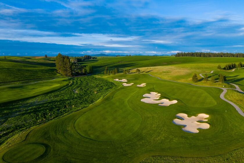 Aerial view of the 5th hole split fairway at Circling Raven Golf Club in Worley Idaho