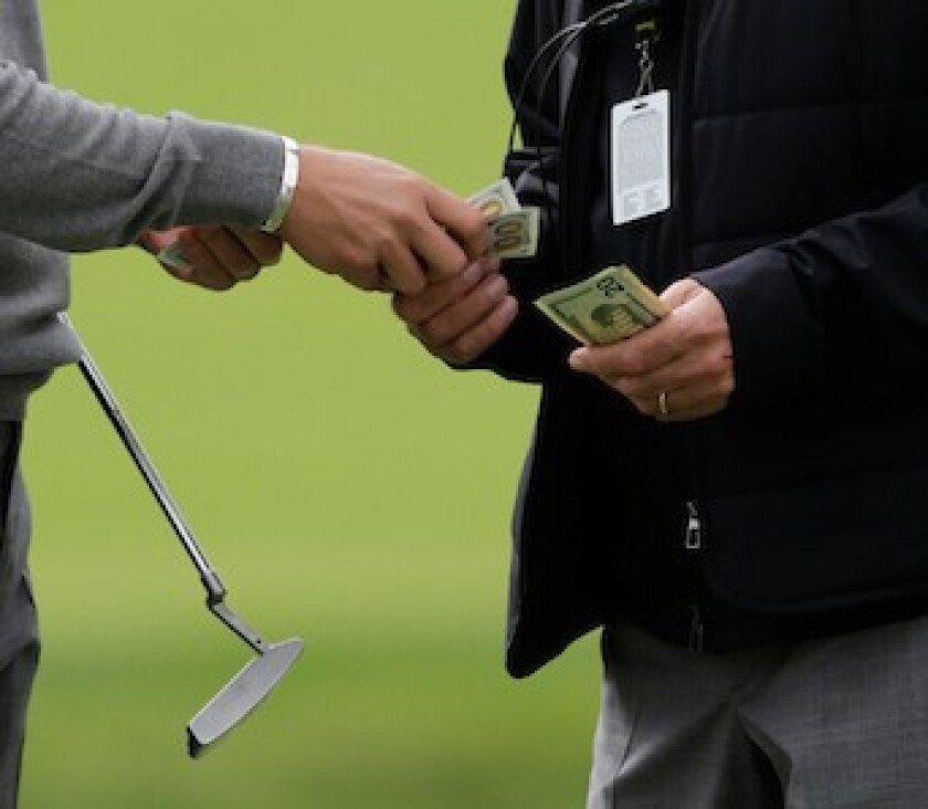 Money changes hands on golf course