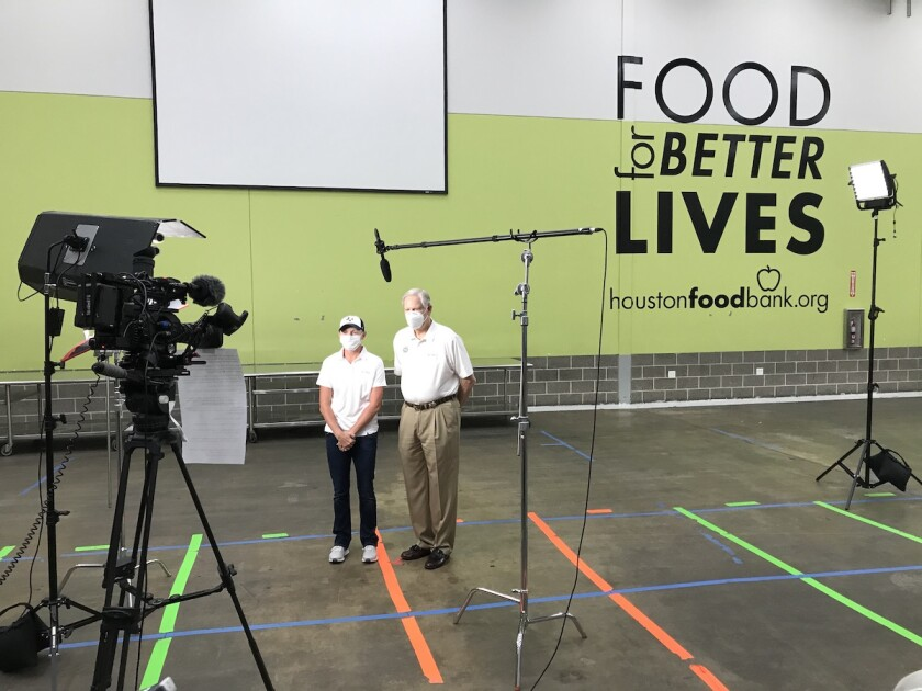 Stacy Lewis and Corby Robertson at Houston Food Bank
