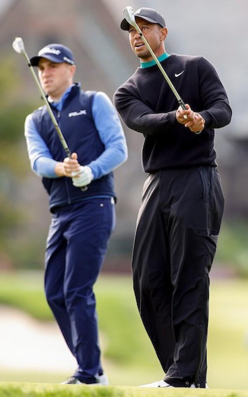 Justin Thomas and Tiger Woods
