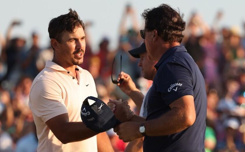 Brooks Koepka congratulates winner Phil Mickelson at 2021 PGA Championship
