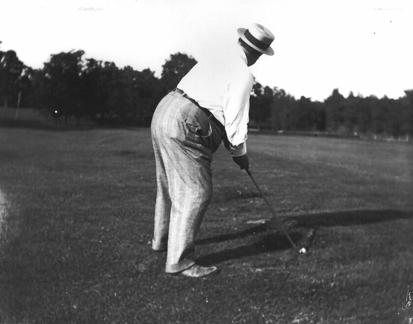 Taft.playing.golf.jpg