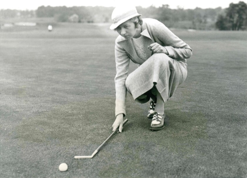 Joyce Wethered lines up a putt