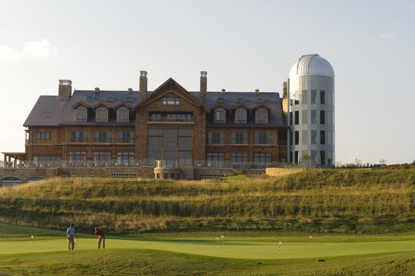 Lodge with golfers playing down below - Primland horizontal.jpg
