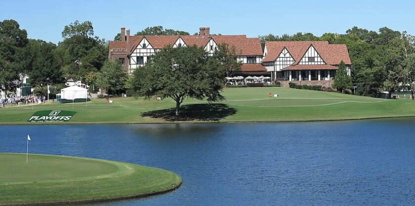 East Lake GC par-3 15th green left clubhouse background.jpg
