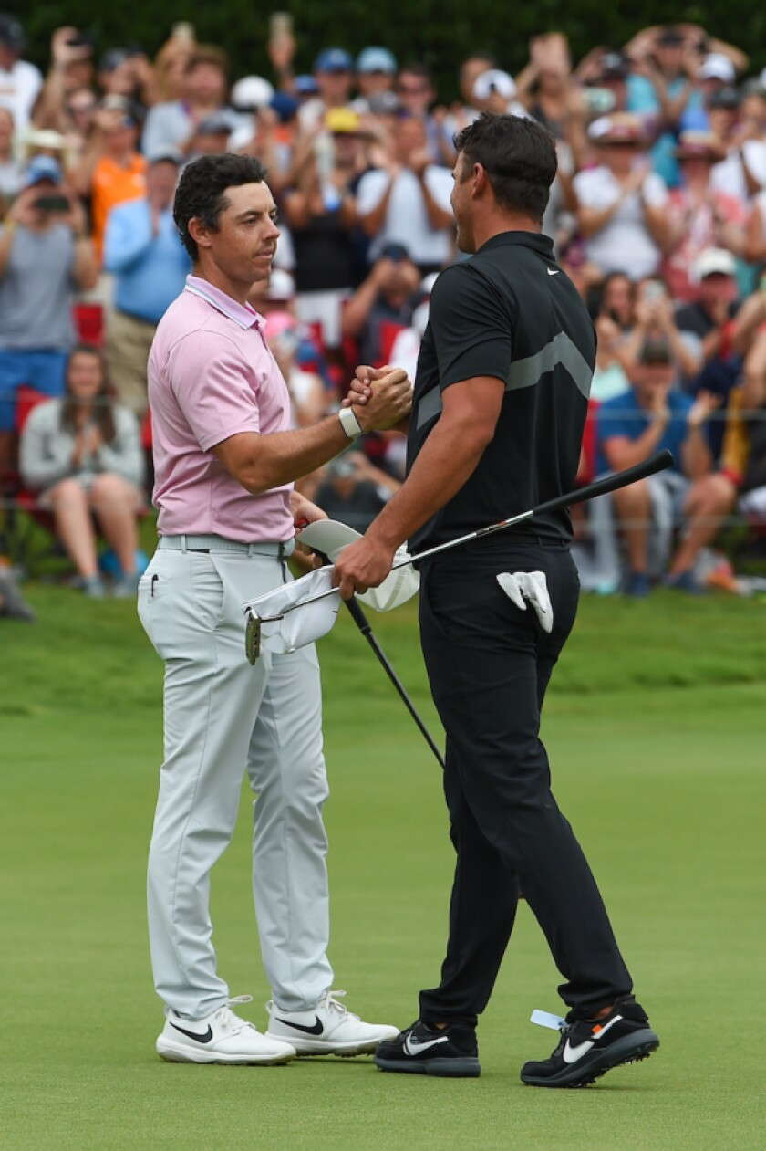 Rory McIlroy congrats from Brooks Koepka at winning FedEx Cup title