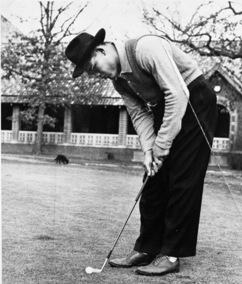 Boxer Joe Louis playing golf