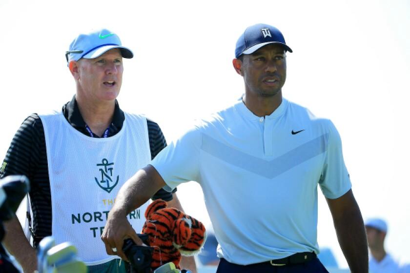 Tiger Woods, with caddie Joe LaCava