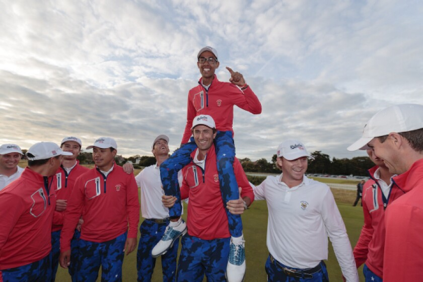 Akshay Bhatia, US Walker Cup Teammate, celebrates on the shoulders of Stewart Hagestad