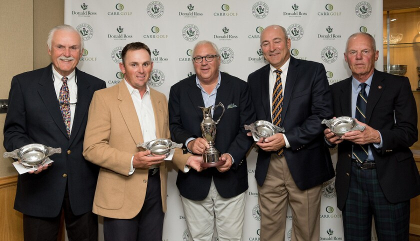 Team Guise presented with the 2019 Donald Ross Pro-Am trophies by Rob Stein, co-founder and president of Donald Ross Sportswear