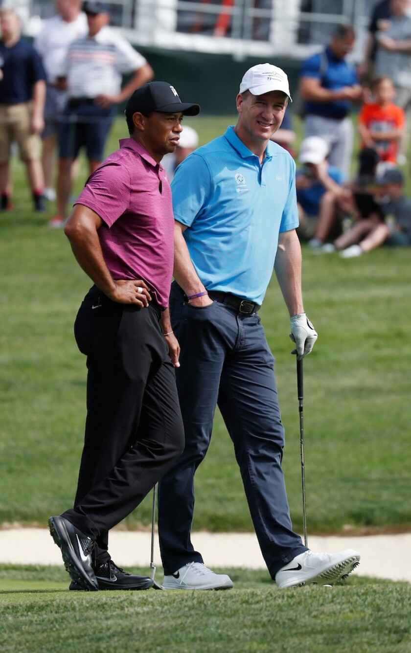 Tiger Woods and Peyton Manning